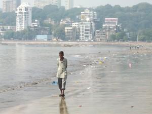 Unemployed Man On Dirty Beach In Mumbai