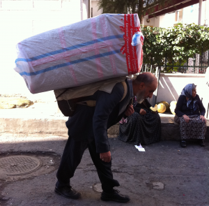 Old Man Carrying A Heavy Load