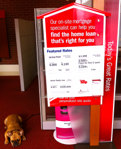 Patiently Waiting French Bulldog Next To Mortgage Sign