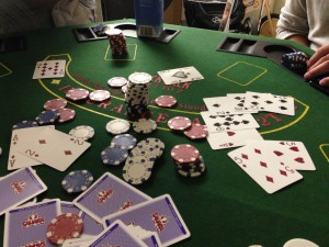 Poker table with scattered cards and chips