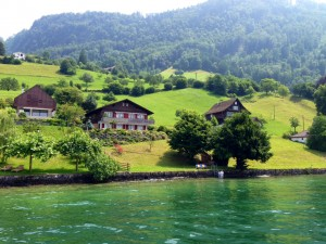 A couple stepping into Lake Lucern from their house