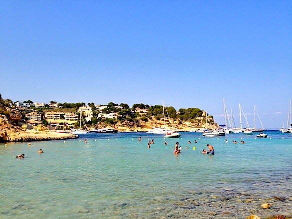 Favorite beach in Mallorca w/ yachts and multi-million dollar homes.