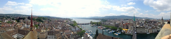 Panoramic view of Zurich atop a church tower.