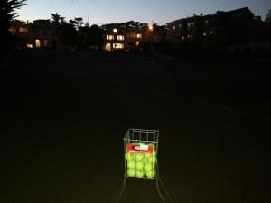 Coaching tennis until dark
