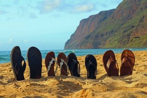 Flip flops in the sand during retirement