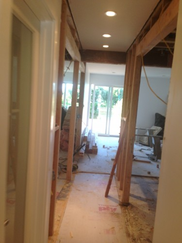 Combining two rooms into one large master bedroom, removed two bathrooms and two closets to make one of each