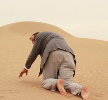 Tough Times Ahead - Man Crawling In Desert