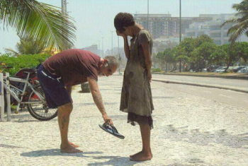 Selfless act of kindness: man giving a homeless woman his slippers